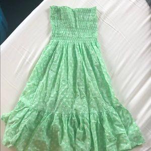 Green and white polka dot smocked dress